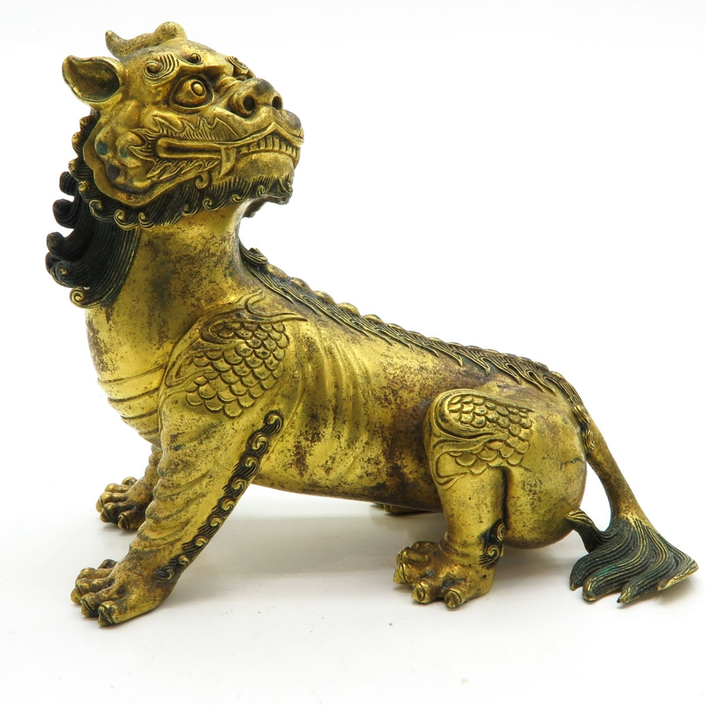 Chinese Gilt Bronze Lion Sculpture